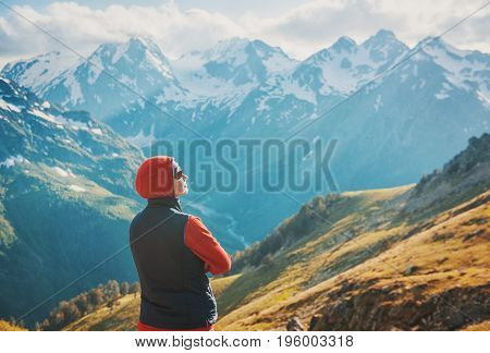Tourist Woman Hiker On The Top Of Mountain