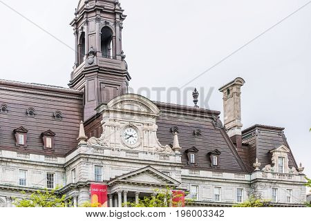 Montreal, Canada - May 27, 2017: Old Town Area With Hotel De Ville City Hall Closeup Of Clock And To