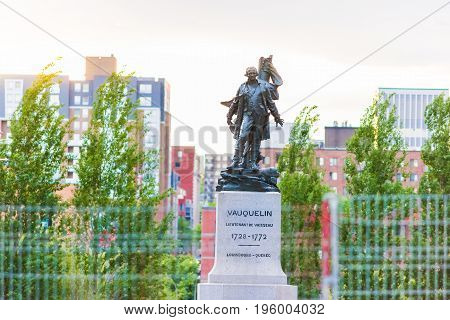 Montreal Canada - May 27 2017: Old town area with closeup of Vauquelin statue