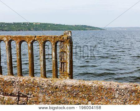 Old Crumbling Concrete Bridge Over The Estuary