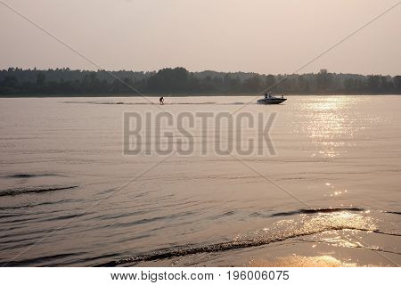 River At Sunset. Summer.august. Water Skiing