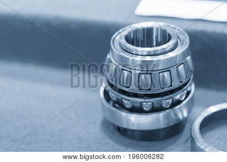 The cylindrical bearing in the blue scene with lighting effect. Mechanical part.