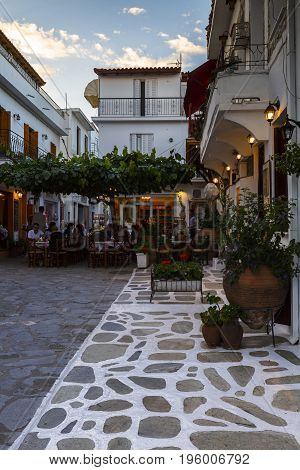 SKIATHOS, GREECE - JUNE 18, 2017: Coffee shop in the old town of Skiathos in Sporades, Greece on June 18, 2017.