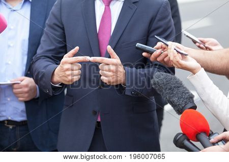 Media interview with business person, politician or spokesperson