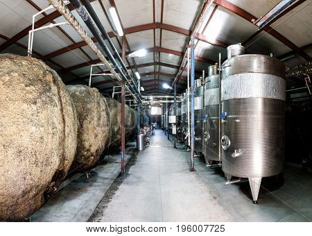 Cisterns on wine production in a wine cellar