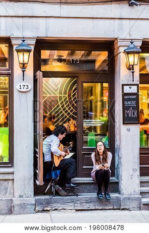 Montreal, Canada - May 27, 2017: Old Town Area With Couple People Playing Guitar And Singing By Hote