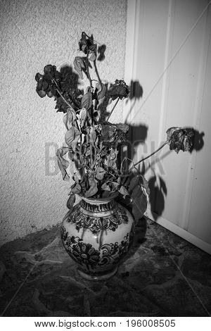 Photograph of a bouquet of flowers in an old vase