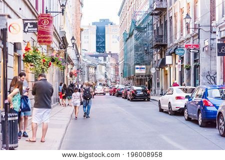 Montreal, Canada - May 27, 2017: Old Town Area With People Walking Up Street And Cars Driving In Eve