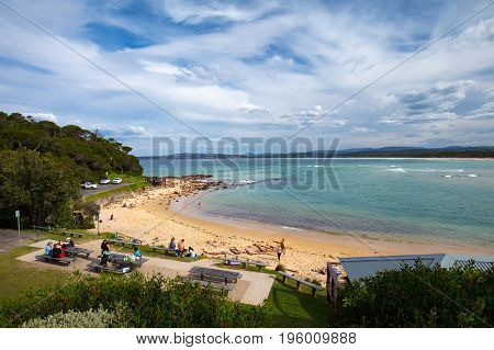 The iconic Boggy Creek from Bar Beach Lookout providing an outlet to the ocean for Merimbula in New South Wales, Australia