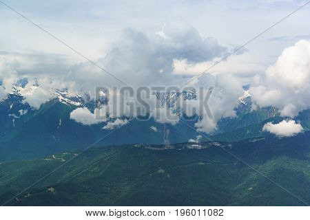 White Clouds Sheltering Peaks Of The Caucasus Mountains