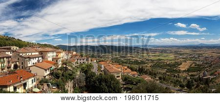 Cortona Italy. Panoramic view of the village and valley below