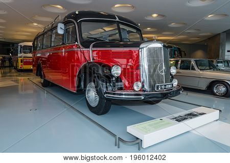 STUTTGART GERMANY- MARCH 19 2016: Vintage bus Mercedes-Benz O3500 touring coach with soft-top 1952. Mercedes-Benz Museum.