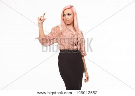 Young surprised woman showing by hands on a gray background. Ideal for banners, registration forms, presentation, landings, presenting concept.