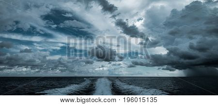 Tropical hurricane from motor boat. Water traces and splashes wake