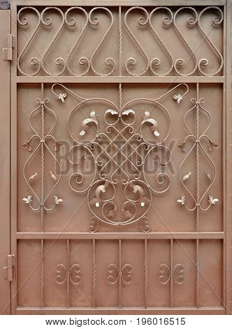The Texture Of The Bronze Metal Gate With A Beautiful Floral Pattern Of Forged Metal