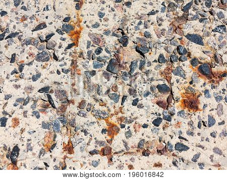 Reinforced Concrete Surface Is Covered With Cracks, Scratches, Inclusions Of Granite And Rusty Metal