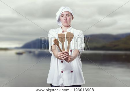 Young Woman Chef Looking Her Wood Utensils