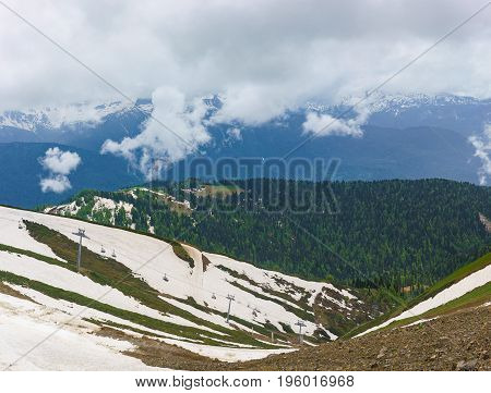 Mountain Gorge And Hillside, Equipped With Cable Cars, With The Remnants Of Snow In The Cloud Summer