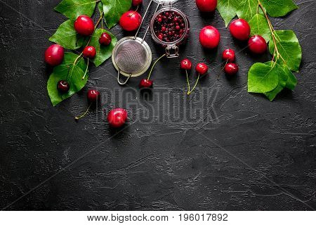 Fruits and berries for summer fruit drink black stone table top view.