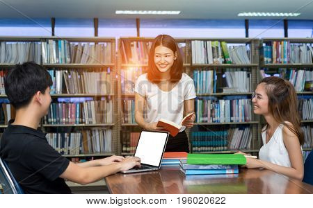 Student Teenage Talking Reading Book using Laptop Computer in Library Room Education Classroom with White Isolated Clipping Path
