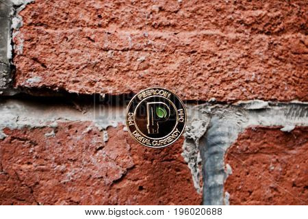 Gold Peercoin On The Wall
