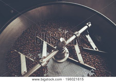 coffee beans in roast machine arabica roasted coffee color vintage style. Thailand