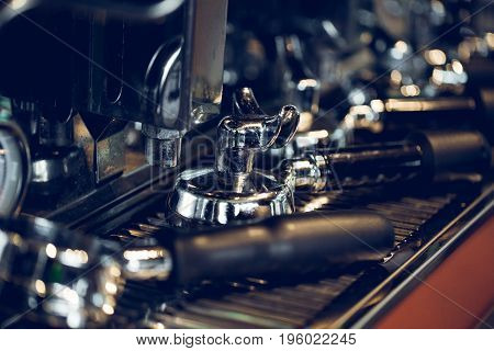 Freshly Grind Coffee in Portafilter. Professional Espresso Making. Coffee Preparing Equipment.Color vintage style.Thailand