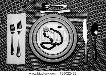 Empty Meal, strange liquid meal on the plate of a semi formal place setting