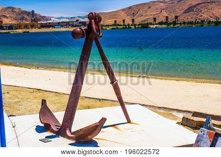 Vintage Rusty Anchor On Display At Local Beach