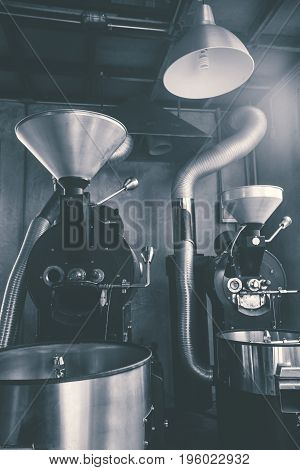 Best professional coffee roasting machine for roasting coffee beans with shiny stainless steel parts looking clean and new with freshly roasted beans Loft style