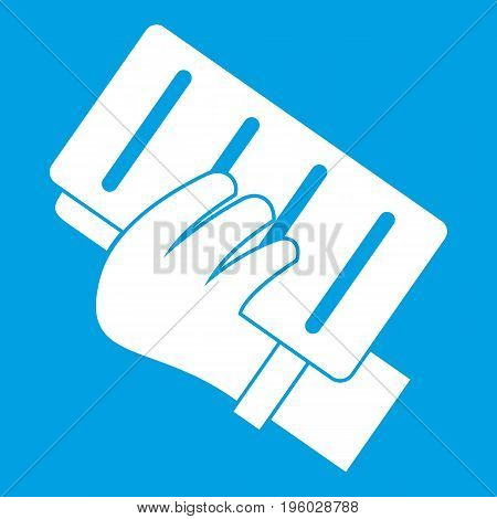 Brick in a hand icon white isolated on blue background vector illustration