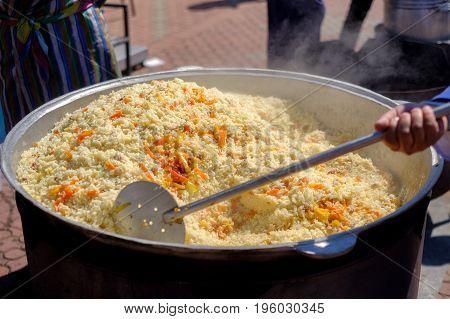 Cooking Uzbek Pilaf Dish In Outdoor With Beef Meat.