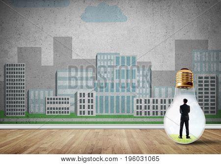 Businessman inside light bulb against city drawn concept