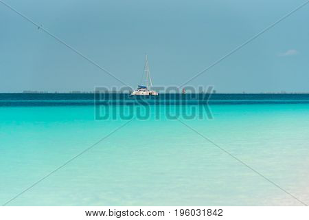 Yacht at the beach Playa Paradise of the island of Cayo Largo Cuba. Copy space for text