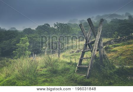 Wooden Ladder Over Fence in Snowdonia National Park