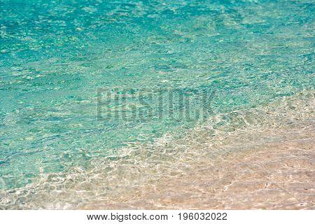 Azure Water Of The Beach Playa Paradise Of The Island Of Cayo Largo, Cuba. Ñlose-up.
