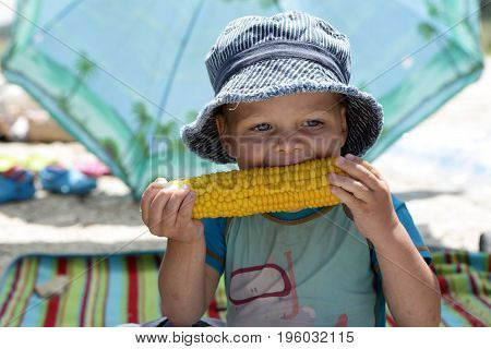Boy Eating Corn