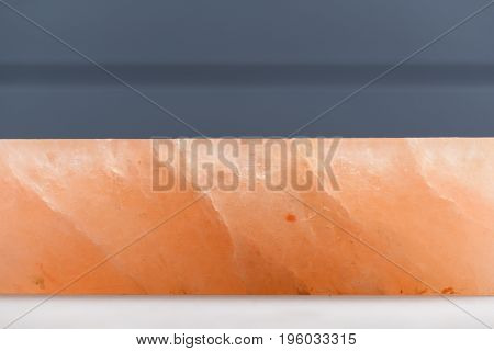 Hymalayan pink salt block with cracks side view copyspace