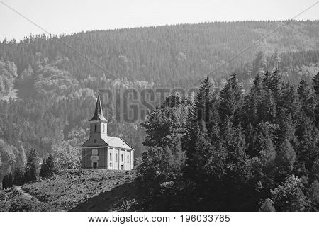 black and white photo of a church in Ostravice built in the hills, Beskydy mountains, Czech republic