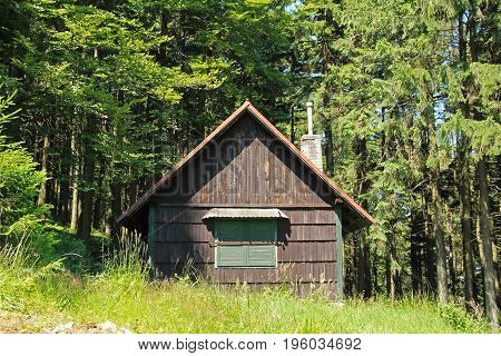 small wooden cabin in the wood, Beskydy mountains, Czech Republic