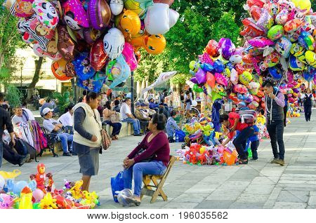 OAXACA MEXICO MARCH 4: Balloon vendors in the street in downtown Oaxaca Mexico on March 4 2017