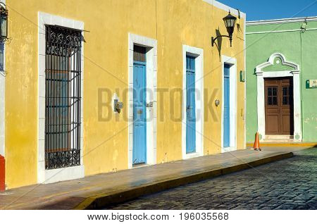 Colorful corner between two colonial houses in the street in Campeche Mexico
