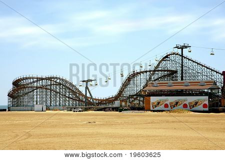 old fashioned wooden rollercoaster on the beach