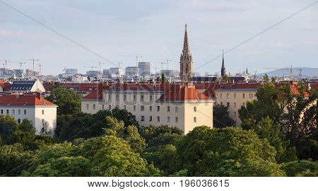 Aerial view of the third municipal district of Vienna with the St.Othmar Church in the center and a lot of construction cranes on the horizon. Vienna, Austria.