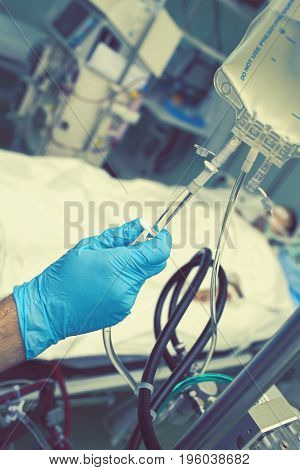 Hand holding valve of the intravenous drip.