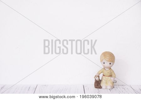 Stock Photography Retro White Wall Wooden Vintage Paint Floor And Ceramic Doll Toy Boy Sheep