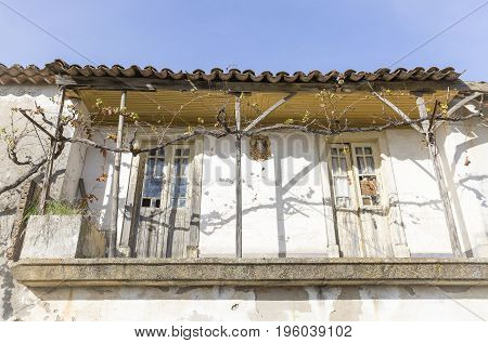 old balcony on a typical white house in Alentejo region, Portugal