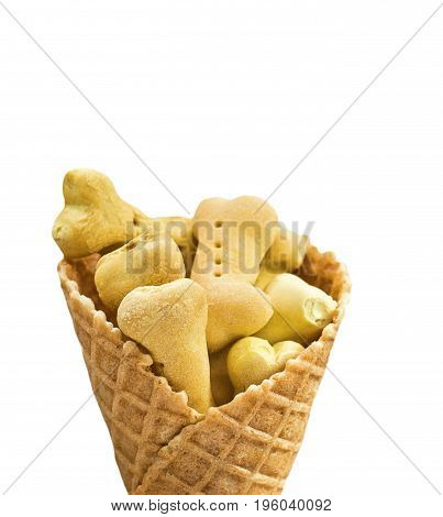 small dog cookies in waffle cone. isolated on a white background. Clipping Path. Dog food