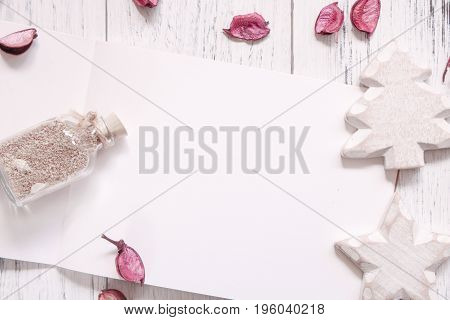 Stock Photography Flat Lay Vintage White Painted Wood Table Blank Note Book Petals Craft Glass Bottl