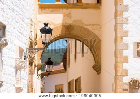 A Street Lamp On The Background Of Buildings In Sitges, Barcelona, Catalunya, Spain.